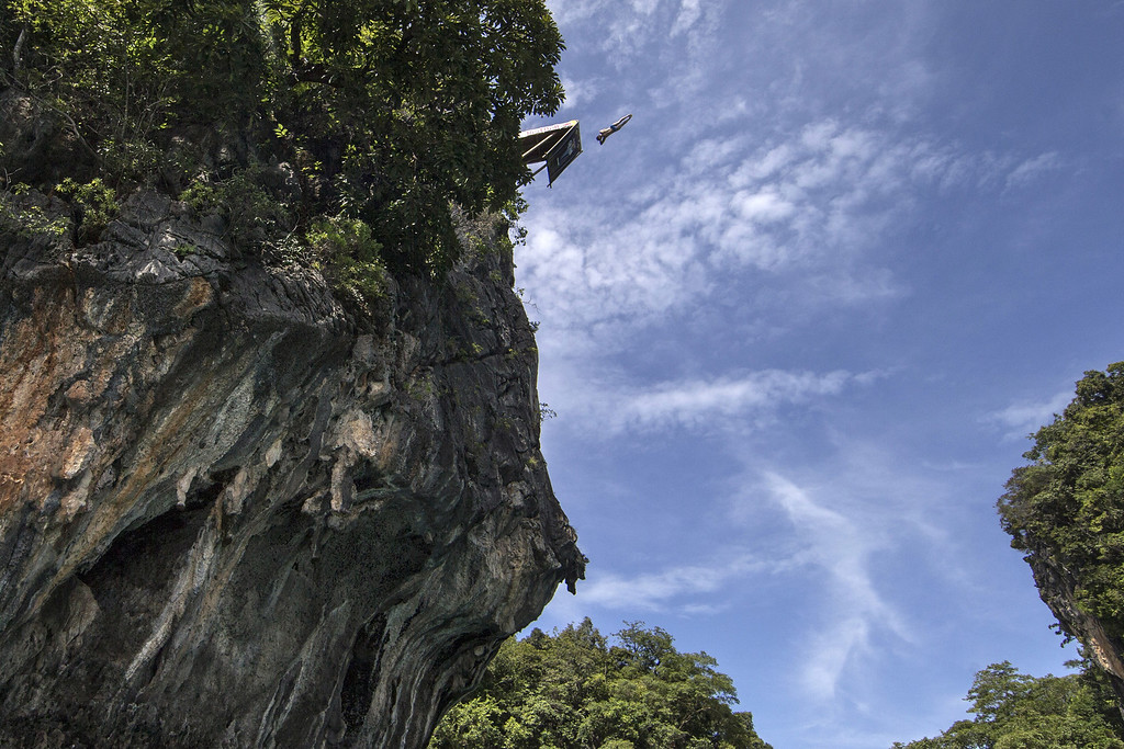 . In this handout image provided by Red Bull, Gary Hunt of the UK dives from the 27 meter platform at training on Hong Island in the Andaman Sea during the final stop of the 2013 Red Bull Cliff Diving World Series on October 25, 2013 at Krabi, Thailand. (Photo by Samo Vidic/Red Bull via Getty Images)