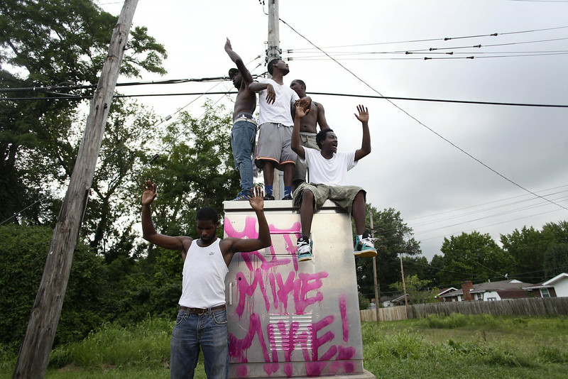 . Demonstrators protest Michael Brown\'s murder with their hands in the air August 17, 2014 in Ferguson, Missouri. Tensions still run high in the Ferguson community after 18 -year-old Michael Brown was killed by a Ferguson Police Officer August 9 on Canfield Drive. (Photo by Joshua Lott/Getty Images)