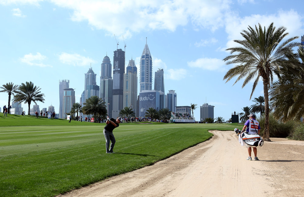 . Stephen Gallacher of Scotland plays his second shot on the eighth hole during the final round of the Omega Dubai Desert Classic at Emirates Golf Club on February 3, 2013 in Dubai, United Arab Emirates.  (Photo by Warren Little/Getty Images)