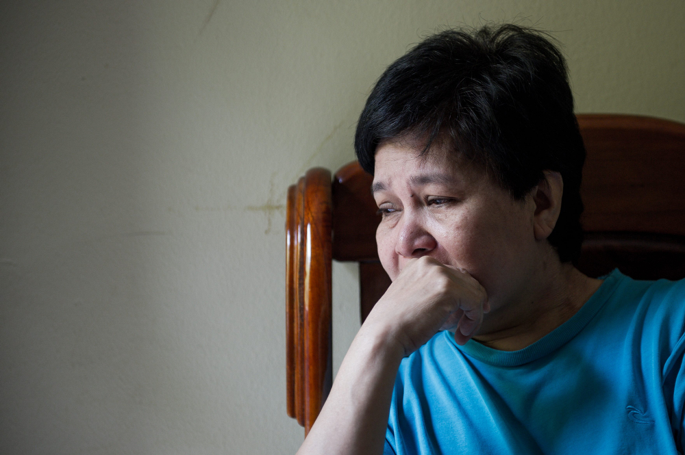 . Sarah Nor, 55, the mother of 34-year-old Norliakmar Hamid, a passenger on a missing Malaysia Airlines Boeing 777-200 plane, talks on a mobile phone at her house in Kuala Lumpur on March 8, 2014. Malaysia and Vietnam on March 8 led a search for a Malaysia Airlines jet that has gone missing over Southeast Asia, as fears mounted over the fate of the 239 people aboard.  (MOHD RASFAN/AFP/Getty Images)