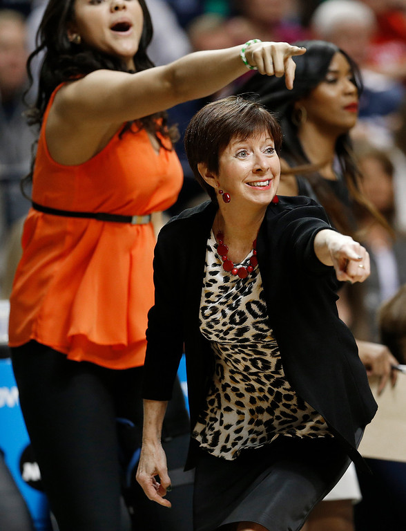 . Notre Dame head coach Muffet McGraw works against Connecticut during the first half of the championship game in the Final Four of the NCAA women\'s college basketball tournament, Tuesday, April 8, 2014, in Nashville, Tenn. (AP Photo/Mark Humphrey)