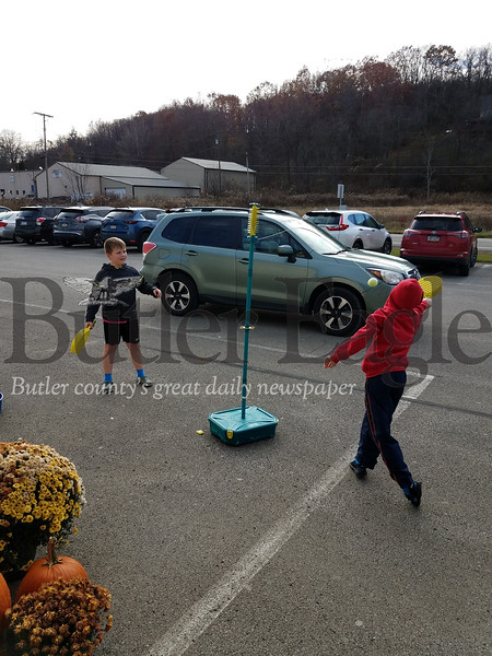 William Thurner, 9, left, and Kaleb Oleath, 10, took a turn at Swingball in the parking lot of Playthings Etc. PHOTO BY ERIC FREEHLING