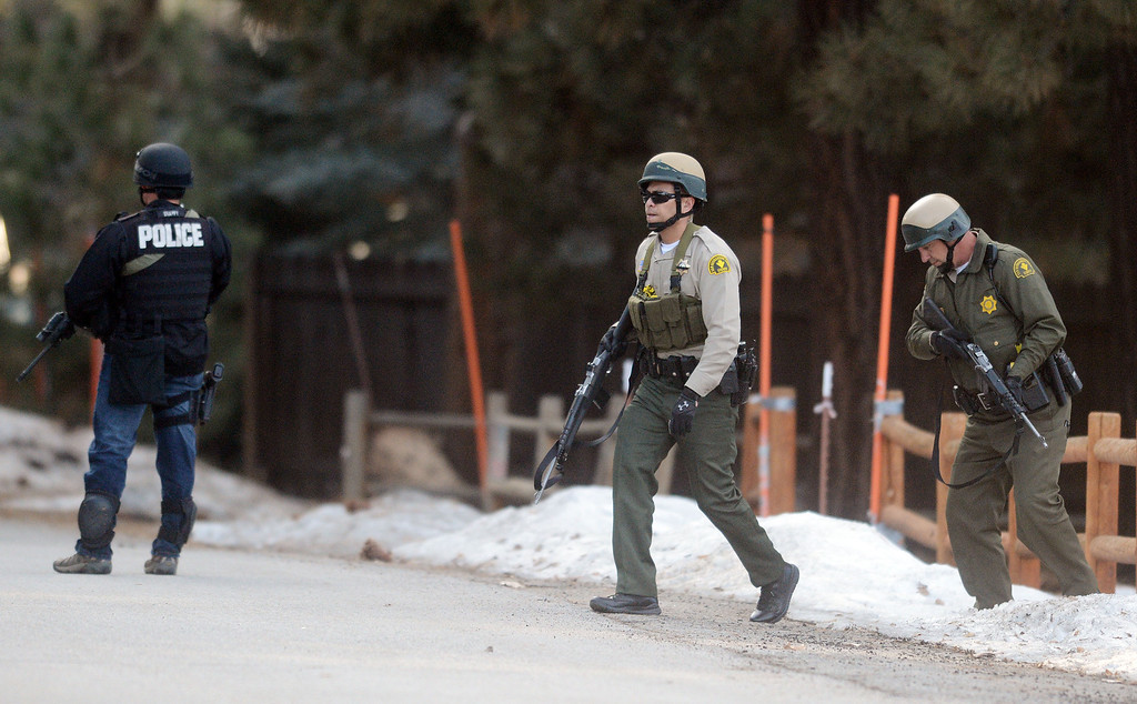 . Law enforcement search door-to-door for ex-LAPD officer Christopher Jordan Dorner near Bear Mountain in Big Bear Thursday February 7, 2013. (Staff photo by Will Lester/Inland Valley Daily Bulletin)
