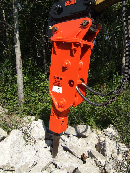NPK GH4 hydraulic hammer with quick attachon Cat backhoe at NPKCE (11).JPG