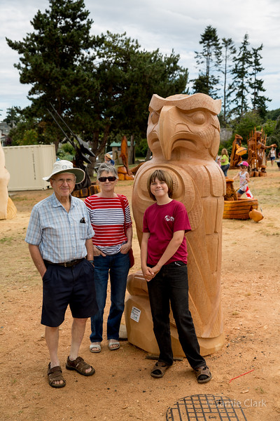 Native owl (with parents and Anton). Chainsaw Sculpture Competition. Campbell River British Columbia