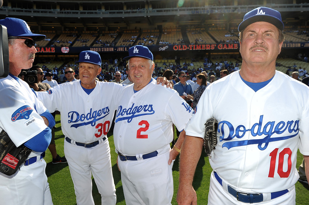 . Former Los Angeles Dodgers manager Tommy Lasorda, right, with Maury Wills (30), Bill Buckner (22) and Ron Cey (10) during the Old-Timers game prior to a baseball game between the Atlanta Braves and the Los Angeles Dodgers on Saturday, June 8, 2013 in Los Angeles. 