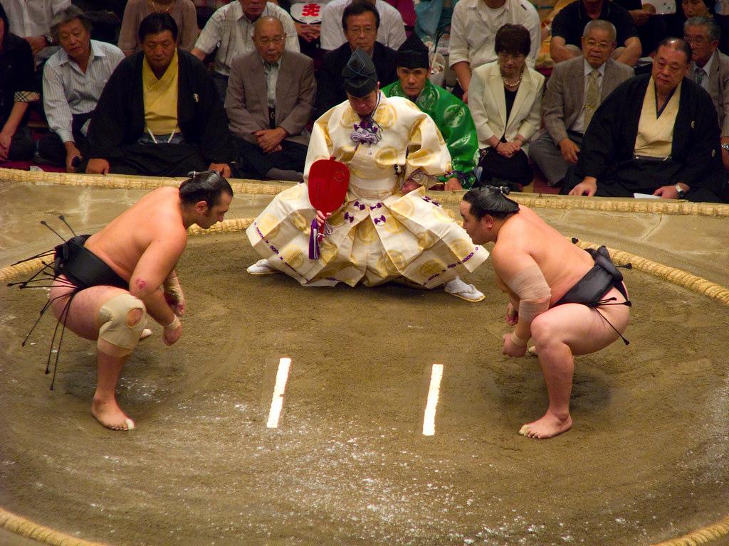 Sumo wrestlers squaring off.