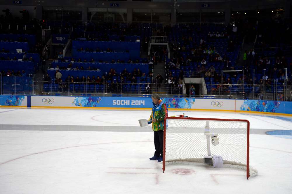 . A worker clears the ice during a break before the third period of the United States\' 3-1 win against Finland. Sochi 2014 Winter Olympics on Saturday, February 8, 2014. (Photo by AAron Ontiveroz/The Denver Post)