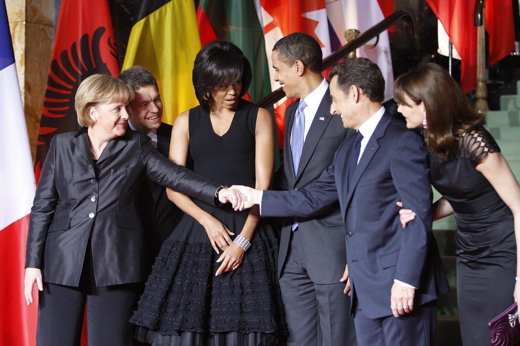 . German Chancellor Angela Merkel, her husband Jochen Sauer, US first lady Michelle Obama, US President Barack Obama, French President Nicolas Sarkozy, and France\'s first lady Carla Buni,  from left,  pose together before a piano concert and working dinner at the Kuhaus in Baden Baden, Germany, Friday April 3, 2009, to celebrate the 60th anniversary of the founding of the North Atlantic Treaty Organization.(AP Photo/Michael Sohn)
