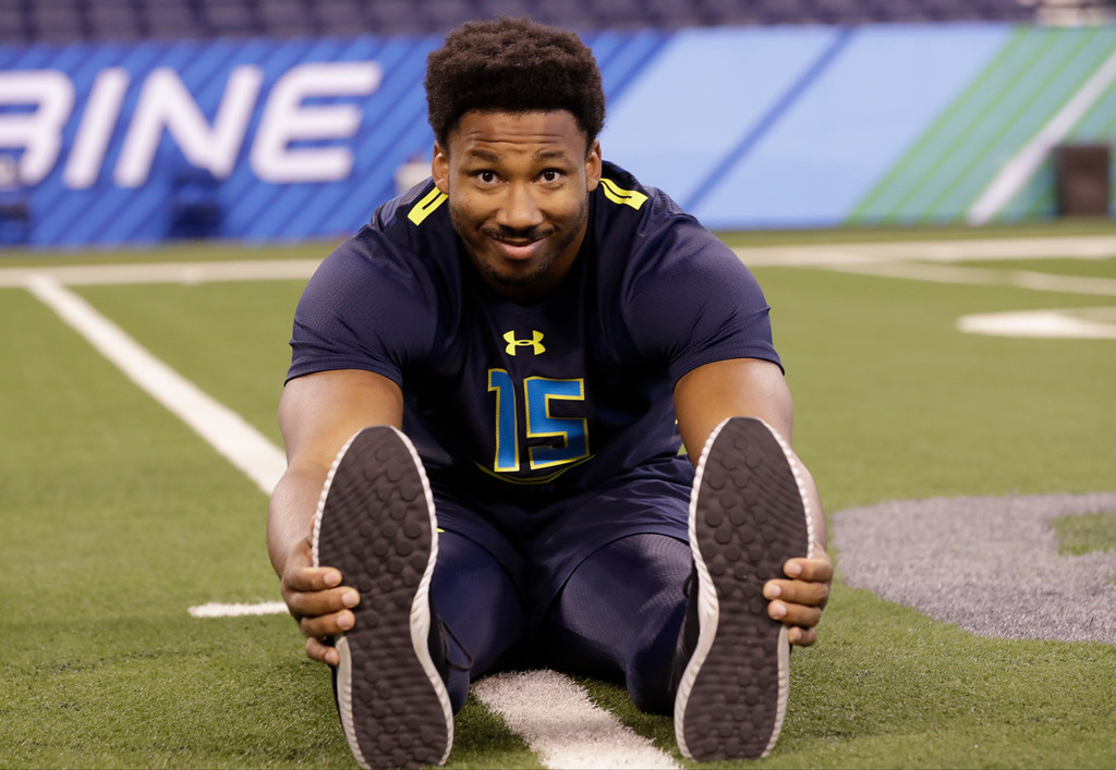 . Texas A&M defensive end Myles Garrett stretches at the NFL football scouting combine Sunday, March 5, 2017, in Indianapolis. (AP Photo/David J. Phillip)