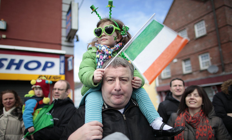 . A father and daughter enjoy the St. Patrick\'s Day parade in Limerick, Ireland, Sunday, March 17, 2013. (AP Photo/Peter Morrison)