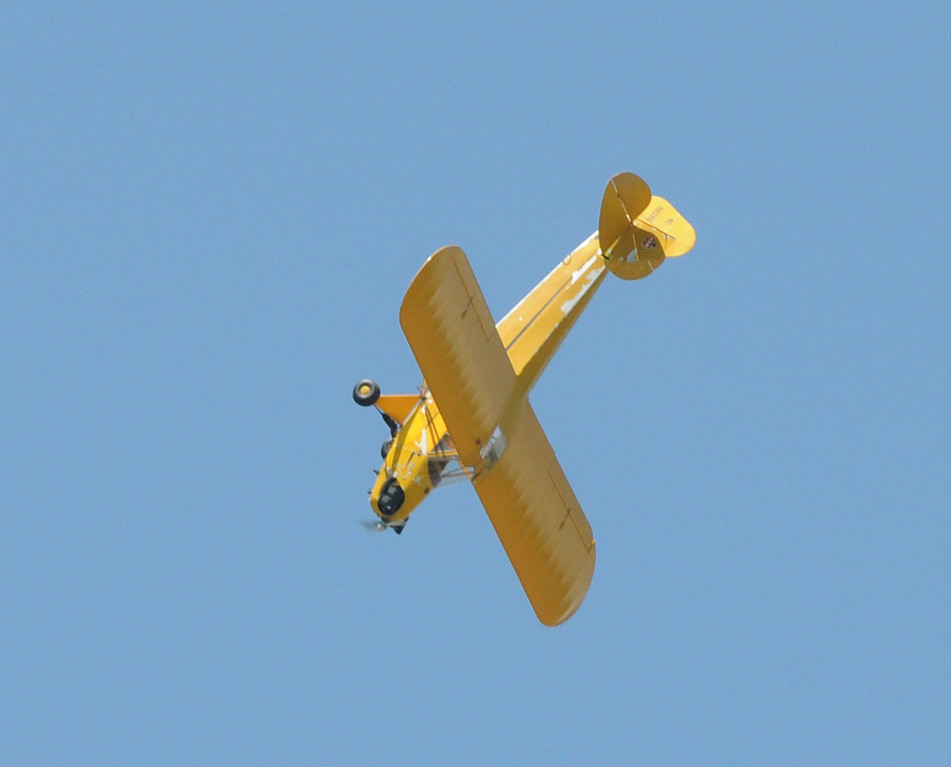 . Jim Bobel/JBobel@MorningJournal.com Emerson Stewart does a loop in his Piper J3 Cub Plane.