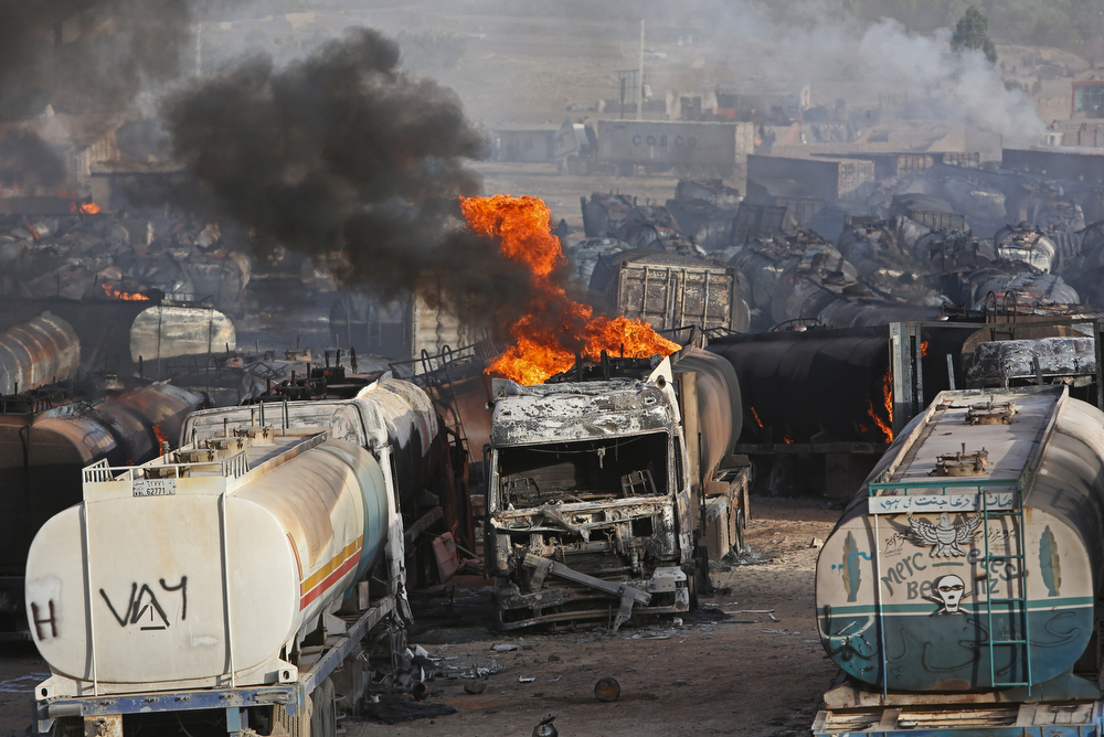 . Flames rise from oil tankers after an attack claimed by Taliban militants on the outskirts of Kabul, Afghanistan, Saturday, July 5, 2014. An Afghan security official says at least 400 fuel tankers caught fire late Friday night in a parking lot in the outskirts of Kabul. (AP Photo/Rahmat Gul)