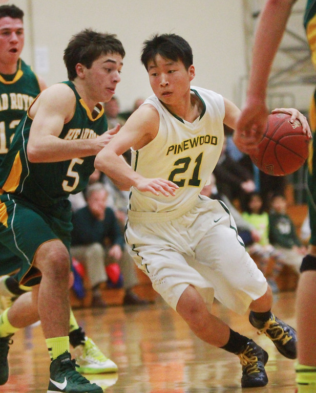 . Pinewood\'s Nathan beak drives the ball to the hoop against Head-Royce\'s Joseph Chipman during a game in the first quarter at Pinewood High School in Los Altos on Wednesday, March 6, 2013.   (Kirstina Sangsahachart/ Daily News)