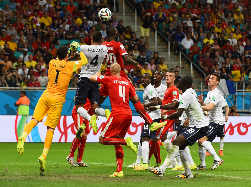 . (FromL) France\'s goalkeeper Hugo Lloris, France\'s defender Raphael Varane and Switzerland\'s defender Johan Djourou jump for the ball during a Group E football match between Switzerland and France at the Fonte Nova Arena in Salvador during the 2014 FIFA World Cup on June 20, 2014. (ANNE-CHRISTINE POUJOULAT/AFP/Getty Images)
