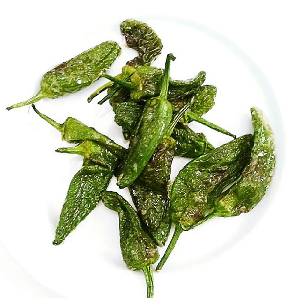 Padr_n_peppers_are_originally_from_the_Galicia_region_of_Spain._Known_as_the_Russian_roulette_of_the_food_world__they_are_normally_sweet_but_20__are_very_hot._They_are_served_quite_simply__tossed_in_olive_oil_then_grilled_and_tossed_in_salt..jpg