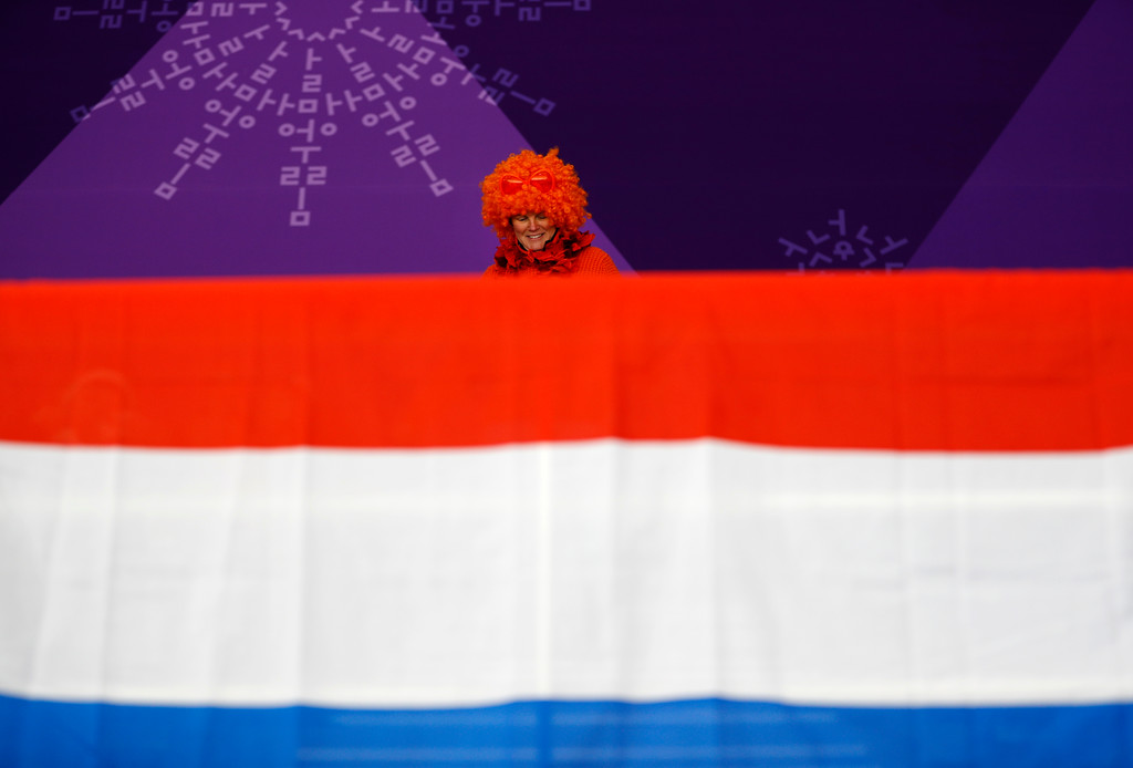. A spectator clad in the colors of the Royal House of Orange takes her seat prior to the men\'s 10,000 meters speedskating race at the Gangneung Oval at the 2018 Winter Olympics in Gangneung, South Korea, Thursday, Feb. 15, 2018. (AP Photo/John Locher)