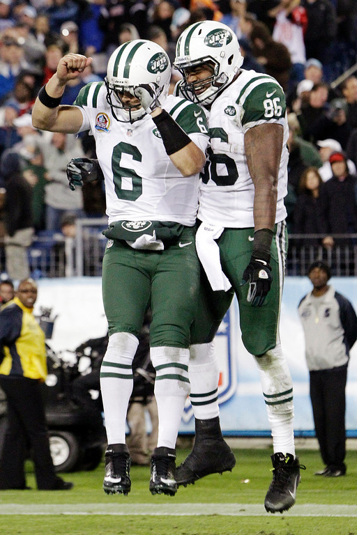 . New York Jets tight end Jeff Cumberland (86) celebrates with quarterback Mark Sanchez (6) after Cumberland scored a touchdown on a 17-yard pass from Sanchez in the third quarter of an NFL football game against the Tennessee Titans, Monday, Dec. 17, 2012, in Nashville, Tenn. (AP Photo/Wade Payne)