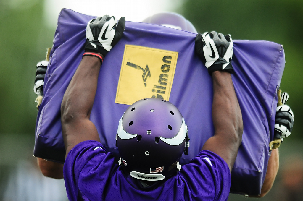 . Minnesota Vikings running back Bradley Randle hits a pad full speed at Vikings training camp in Mankato, Minn., on Friday, July 26, 2013. (Pioneer Press: Ben Garvin)