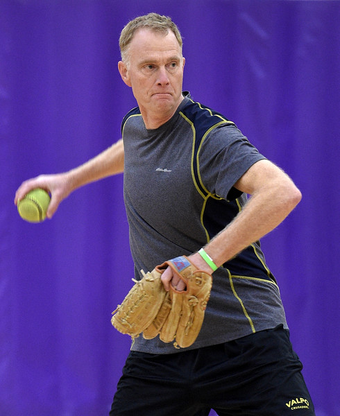 Glen Campbell of Rochester Hills winds up to throw a pitch during softball practice at the Rochester Older Persons Commission on March 26, 2018. (Digital First Media Gallery by David Dalton)