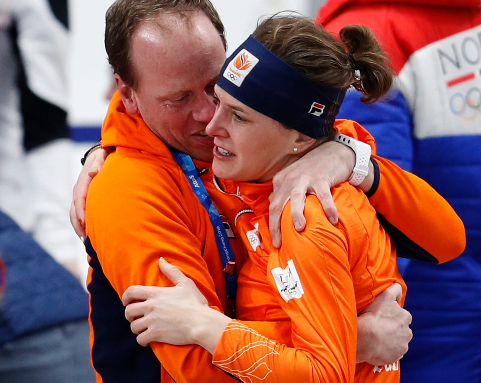 . Gold medallist Ireen Wust of Netherlands hugs her coach after the women\'s 1,500 meters speedskating race at the Gangneung Oval at the 2018 Winter Olympics in Gangneung, South Korea, Monday, Feb. 12, 2018. (AP Photo/John Locher)