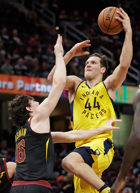 . Indiana Pacers\' Bojan Bogdanovic (44), from Croatia, drives to the basket against Cleveland Cavaliers\' Cedi Osman (16), from Turkey, in the second half of Game 1 of an NBA basketball first-round playoff series, Sunday, April 15, 2018, in Cleveland. The Pacers won 98-80. (AP Photo/Tony Dejak)