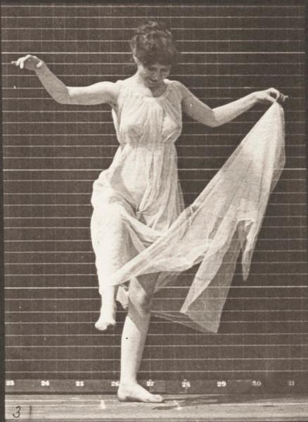 Woman in long dress dancing