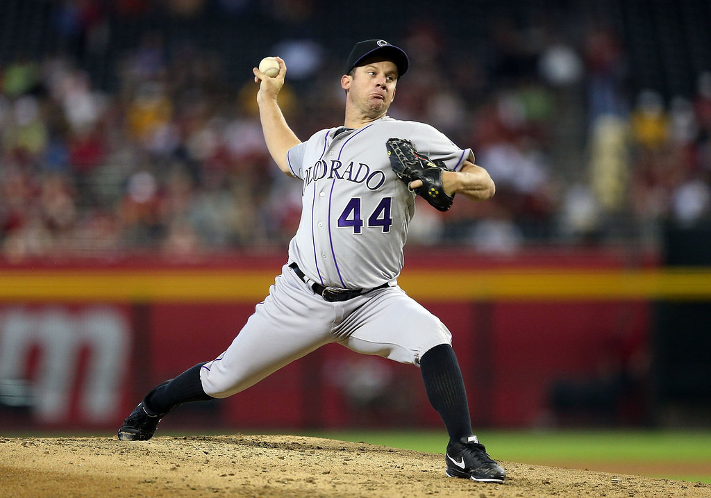 . Starting pitcher Roy Oswalt #44 of the Colorado Rockies pitches against the Arizona Diamondbacks during the MLB game at Chase Field on July 7, 2013 in Phoenix, Arizona.  (Photo by Christian Petersen/Getty Images)
