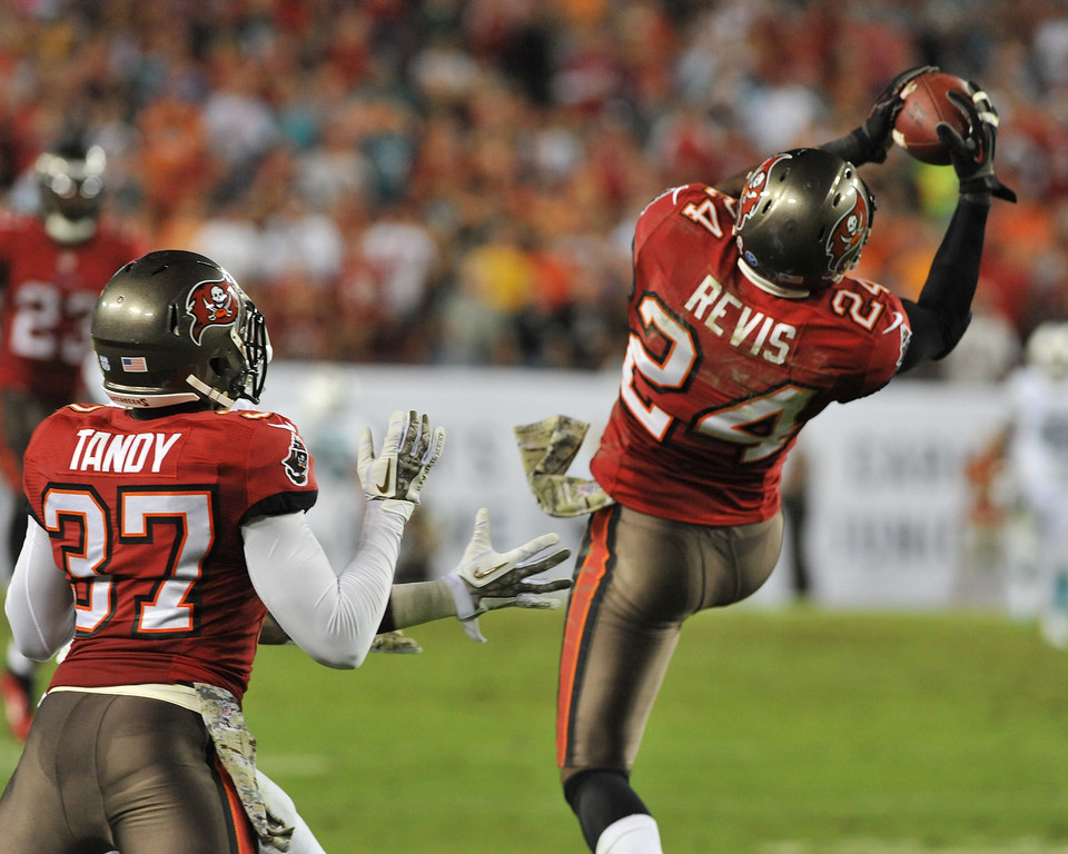 . Cornerback Darrelle Revis #24 of the Tampa Bay Buccaneers stretches for a 4th-quarter interception against the Miami Dolphins November 11, 2013 at Raymond James Stadium in Tampa, Florida. Tampa won 22 - 19. (Photo by Al Messerschmidt/Getty Images)