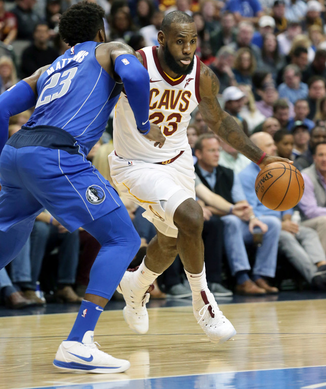 . Cleveland Cavaliers forward LeBron James (23) drives against Dallas Mavericks guard Wesley Matthews (23) during the first half of an NBA basketball game in Dallas, Saturday, Nov. 11, 2017. (AP Photo/LM Otero)