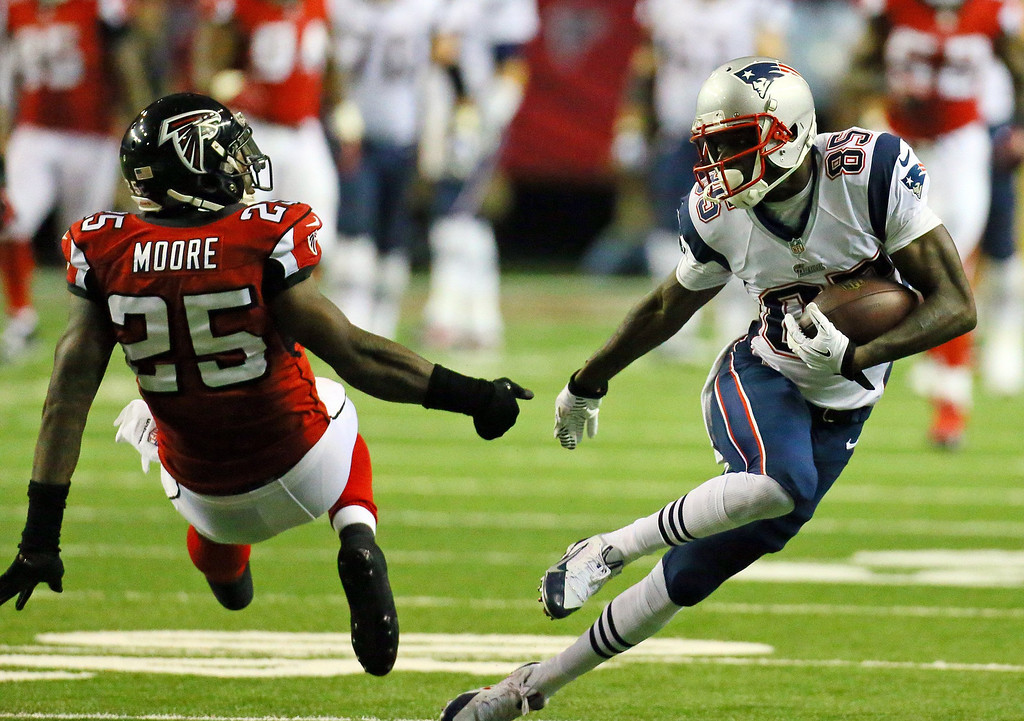 . New England Patriots wide receiver Kenbrell Thompkins makes a long first down catch past Atlanta Falcons safety William Moore during the second quarter on Sunday, September 29, 2013, in Atlanta, Georgia. (Curtis Compton/Atlanta Journal-Constitution/MCT)