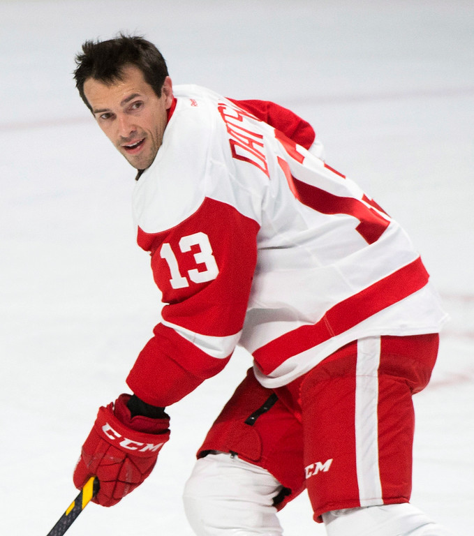 . Detroit Red Wings\' Pavel Datsyuk warms up prior to an NHL hockey game against the Montreal Canadiens in Montreal, Tuesday, Oct. 21, 2104. Datsyuk was cleared to play against Montreal after missing the first five games of the season with a shoulder injury. (AP Photo/The Canadian Press, Graham Hughes