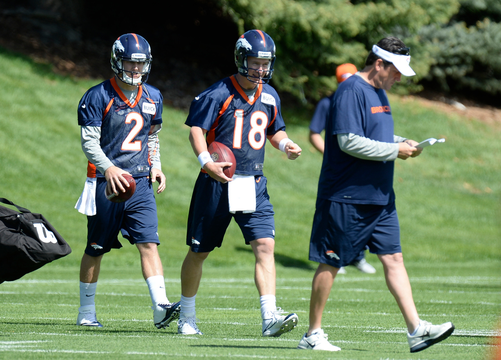 . Zac Dysert (2) of the Denver Broncos and Peyton Manning (18) head to the next station during the teams ota\'s May 20, 2013 at Dove Valley. (Photo By John Leyba/The Denver Post)