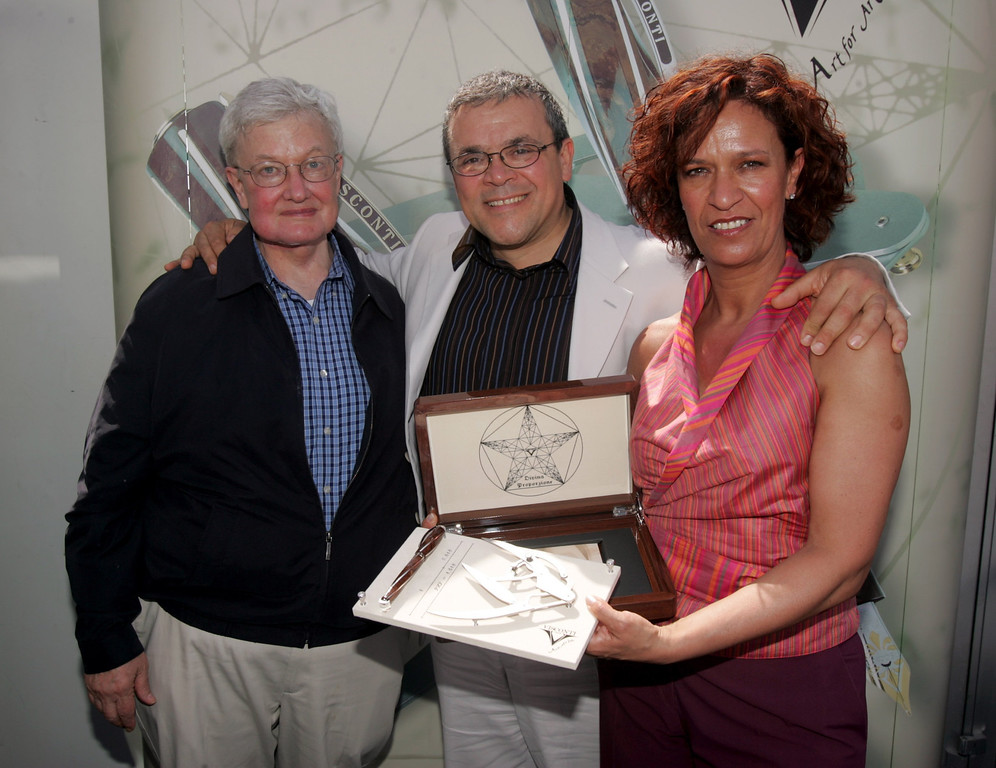 . CANNES, FRANCE - MAY 22:  (L-R) US journalist Roger Ebert, President of Visconti Dante Delvecchio and Maria Carla Benedetti pose for a picture during a Visconti \'Divine Proportion\' event during the 59th International Cannes Film Festival May 22, 2006 in Cannes, France.  (Photo by Getty Images/Getty Images for Visconti)