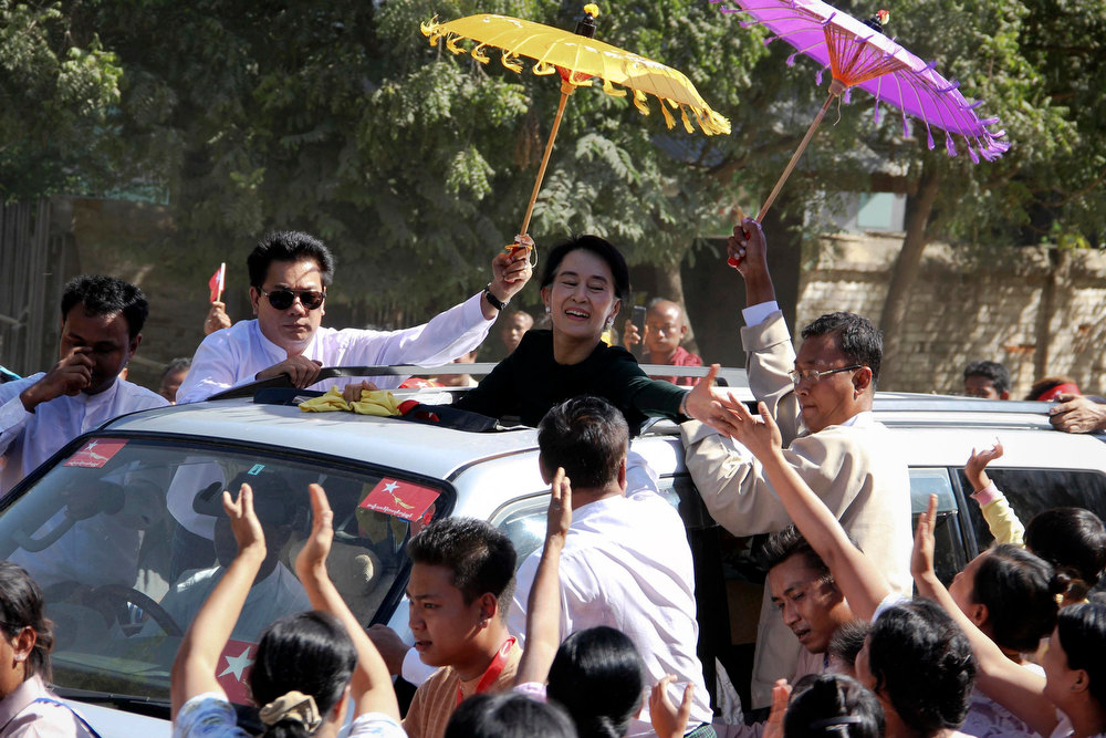 Description of . Aung San Suu Kyi arrives in Monywa for a scheduled visit, after protesters clashed with police at a copper mine in the Sagaing region in Myanmar\'s northwest November 29, 2012. Riot police fired water cannon and tear gas on Thursday to break up a three-month protest against a vast copper mining project run by the powerful Myanmar military and its partner, a subsidiary of a Chinese arms manufacturer. Activists said at least 50 people had been injured and 23 were in hospital, some suffering burns after incendiary devices were hurled into their camps by police. REUTERS/Stringer
