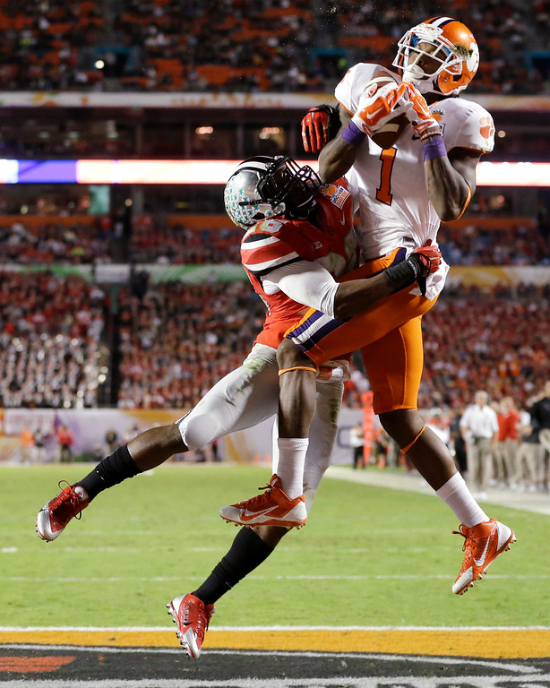 . Clemson wide receiver Martavis Bryant (1) makes a catch for a touchdown as Ohio State cornerback Armani Reeves defends during the first half of the Orange Bowl NCAA college football game, Friday, Jan. 3, 2014, in Miami Gardens, Fla. (AP Photo/Wilfredo Lee)