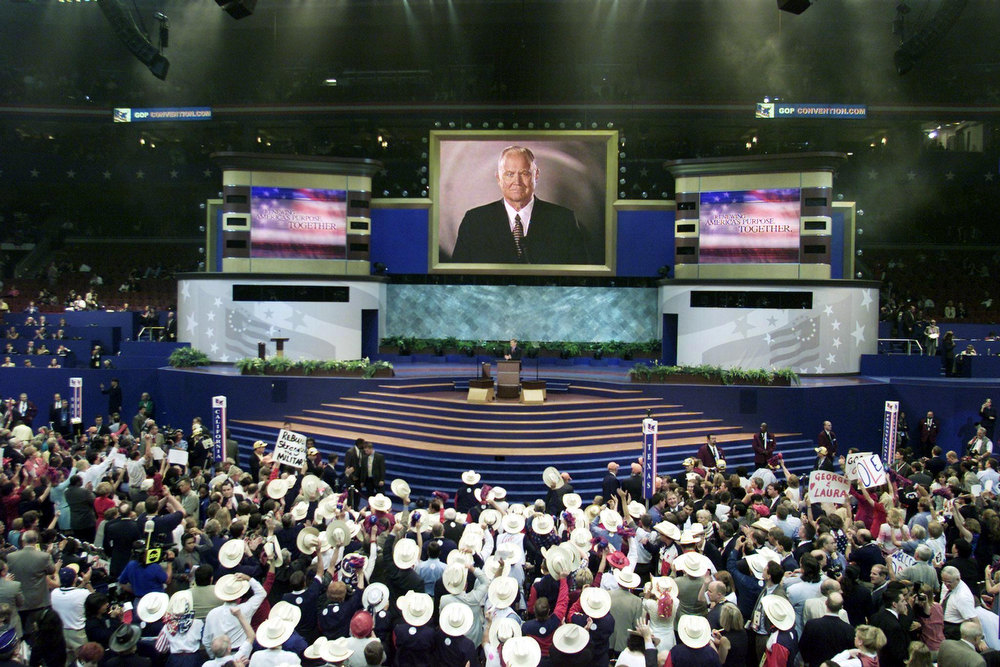 Description of . Retired US General Norman Schwarzkopf, commander of Desert Storm during the war against Iraq, is be seen on the big screen as he speaks via satellite from the battleship New Jersey to the Republican National Convention at the First Union Center in Philadelphia, Pennsylvania, 01 August, 2000. STEVE JAFFE/AFP/Getty Images