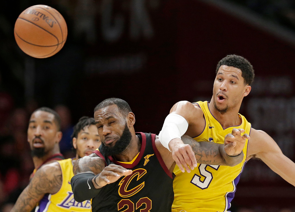 . Cleveland Cavaliers\' LeBron James, front left, and Los Angeles Lakers\' Josh Hart, right, battle for the ball in the second half of an NBA basketball game, Thursday, Dec. 14, 2017, in Cleveland. (AP Photo/Tony Dejak)