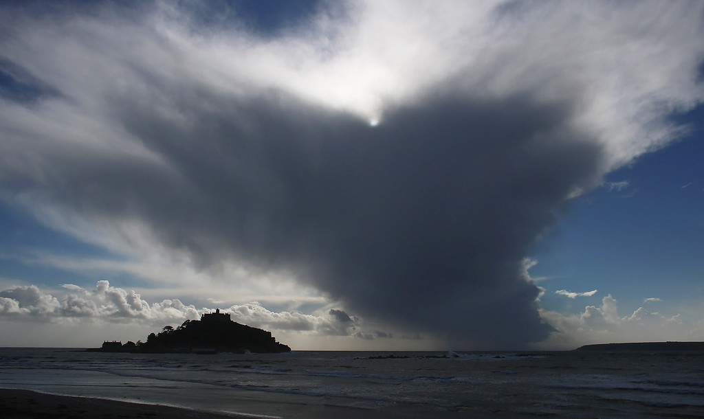 . Rain clouds gather above St Michael\'s at Marazion near Penzance on October 28, 2013 in Cornwall, England.   (Photo by Matt Cardy/Getty Images)
