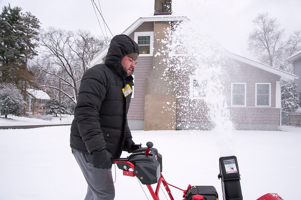 12/02/19 Wesley Bunnell | StaffrrJoshua Lynch makes quick work of the sidewalk around his house with a snowblower on Monday afternoon.