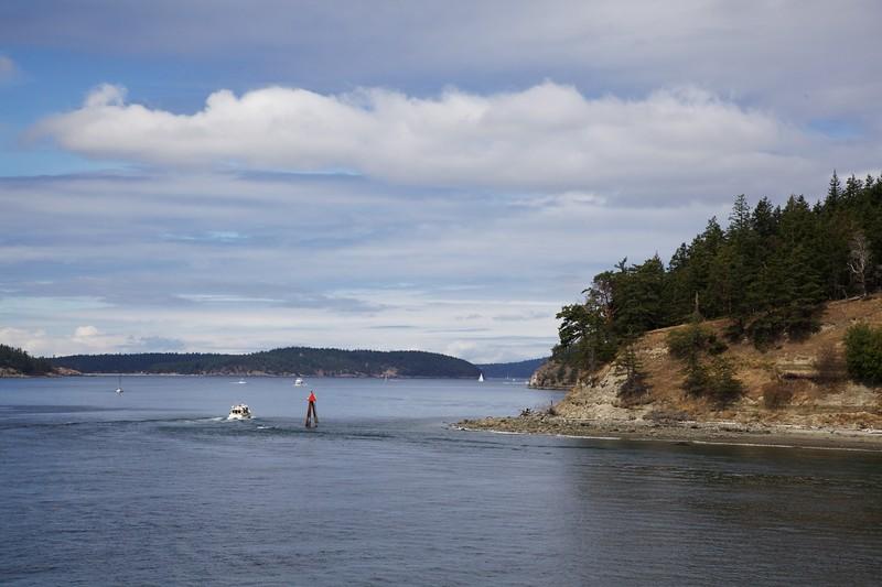 A motor cruiser passes a navigation marker on at the south end of Blakely Island. San Juan Islands, Washington