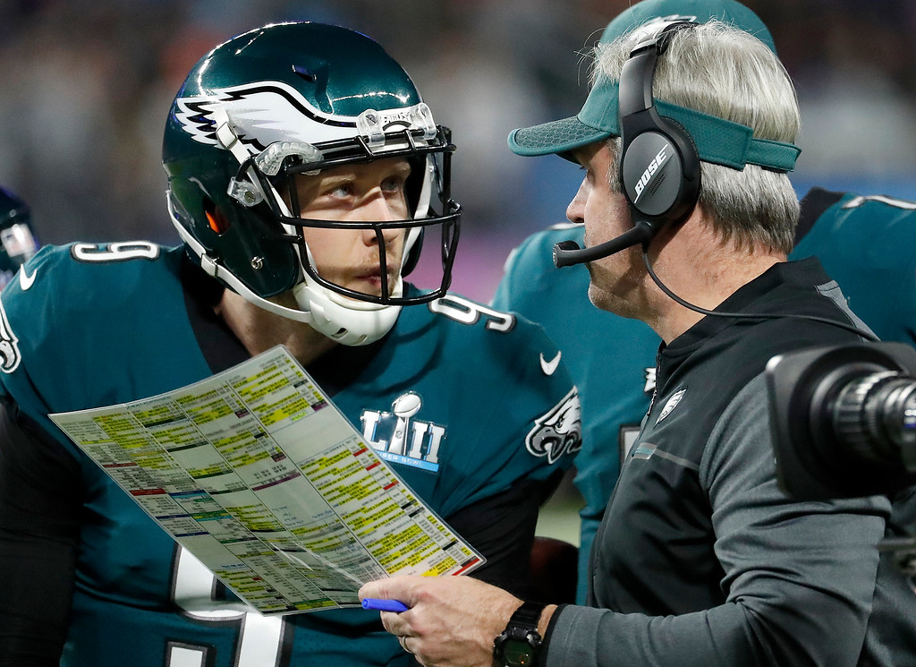 . Philadelphia Eagles head coach Doug Pederson, right, talks to Nick Foles during the first half of the NFL Super Bowl 52 football game against the New England Patriots Sunday, Feb. 4, 2018, in Minneapolis. (AP Photo/Matt York)