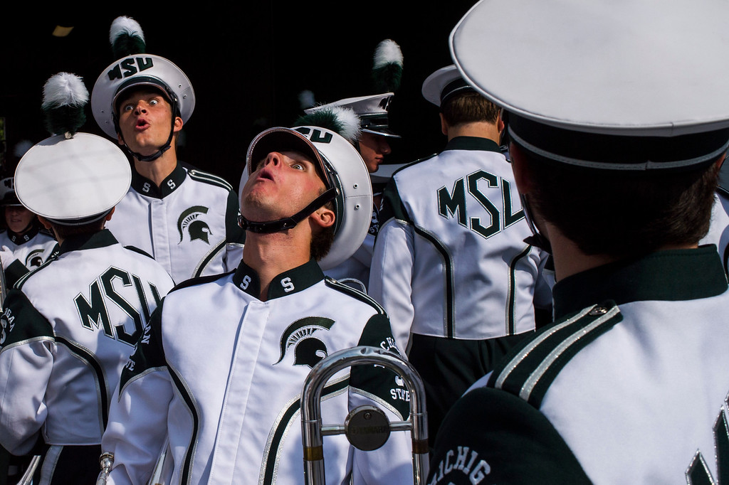 . Michigan State marching band members make funny faces while shouting out to rev up the band and crowd preparing to take the field before the game on Saturday, Sept. 20, 2014 at Spartan Stadium in East Lansing, Mich. (AP Photo/The Flint Journal, Jake May)