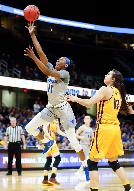 . Buffalo guard Theresa Onwuka goes up for a shot past Central Michigan forward Reyna Frost during the first half of an NCAA college basketball game in the championship of the Mid-American Conference tournament Saturday, March 10, 2018, in Cleveland. Central Michigan won 96-91. (AP Photo/Ron Schwane)