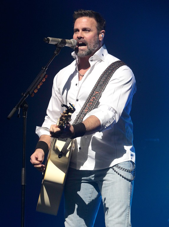 . FILE - In this Jan. 17, 2013 file photo, Troy Gentry of the Country Music duo Montgomery Gentry performs on the Rebels On The Run Tour in Lancaster, Pa. Gentry, one half of the award-winning country music duo Montgomery Gentry, died Friday, Sept. 8, 2017, in a helicopter crash, according to a statement from the band�s website. He was 50.  The group was supposed to perform Friday at the Flying W Airport & Resort in Medford, N.J. (Photo by Owen Sweeney/Invision/AP, File)