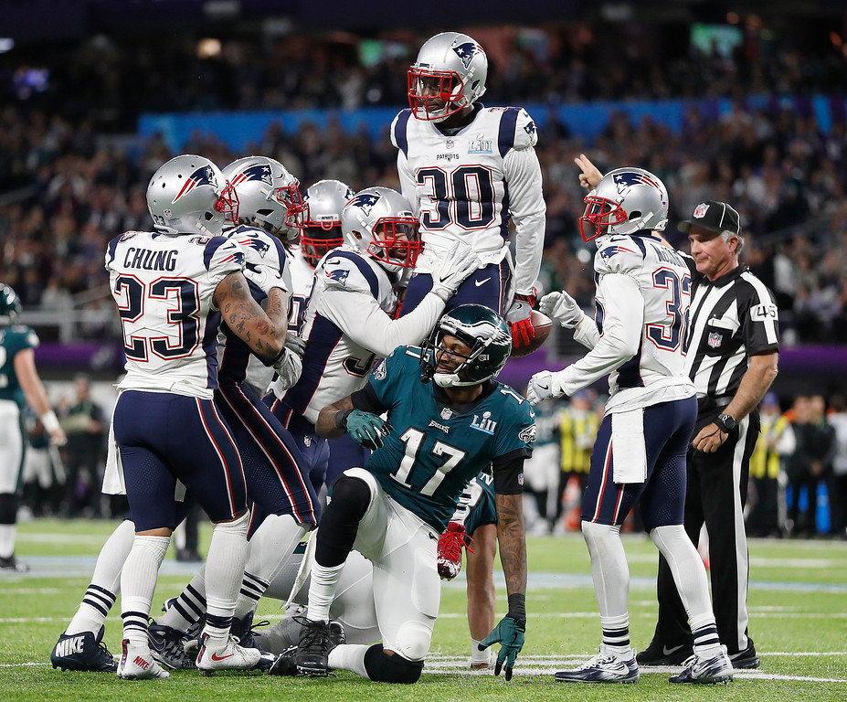 . New England Patriots\' Duron Harmon (30) celebrates his interception of a pass intended for Philadelphia Eagles\' Alshon Jeffery (17) during the first half of the NFL Super Bowl 52 football game Sunday, Feb. 4, 2018, in Minneapolis. (AP Photo/Jeff Roberson)