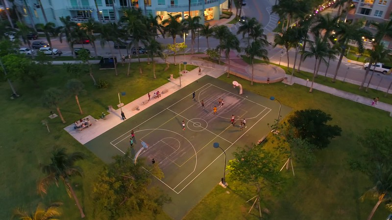 Aerial reveal basketball game in the park