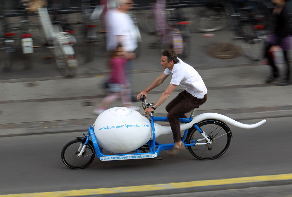 . In this undated photo is the spermbike \' Spermbullit \' is seen on the streets of Copenhagen, Denmark. European cities promote cycling with everything from ësuperhighwaysí to revolving bike racks.  More and more companies use custom-made bikes to carry packages of particular shapes and sizes. Some are designed to serve as billboards for companies, like the ìsperm bikeî used by a Danish sperm bank to transport sperm to fertility clinics in Copenhagen.(AP Photo/European Sperm Bank/POLFOTO/handout)