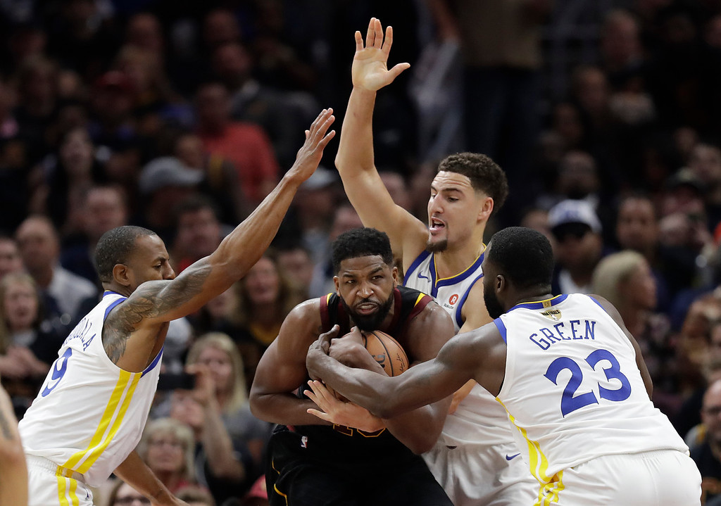 . Cleveland Cavaliers\' Tristan Thompson is defended by Golden State Warriors\' Andre Iguodala, left, Klay Thompson and Draymond Green, right, during the first half of Game 3 of basketball\'s NBA Finals, Wednesday, June 6, 2018, in Cleveland. (AP Photo/Tony Dejak)