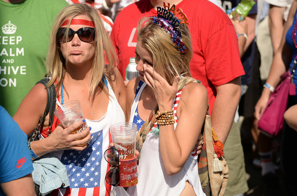 . Kalyn Carpenter, left, comforts her friend Amber Phippls while watching the  USA vs.  Belgium in the World Cup game at the British Bulldog in Denver, Colorado, July 01, 2014. Belgium eliminated U.S. from World Cup with 2-1 win. (Photo by Hyoung Chang/The Denver Post)
